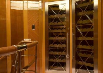 Wine storage in the hall of a private superyacht in South Florida by Patrick Knowles Designs