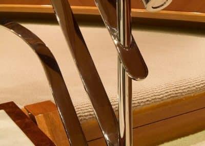 Closeup image of a metal stairway railing