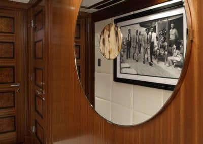 Mirror showcasing the reflection of art on a Patrick Knowles yacht interior design