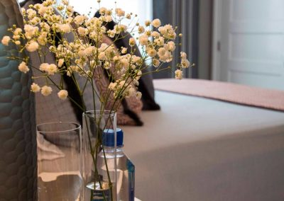 Baby's breath bedside in a bedroom designed by Patrick Knowles
