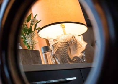 Mirror reflecting a fish lamp in a Patrick Knowles interior design