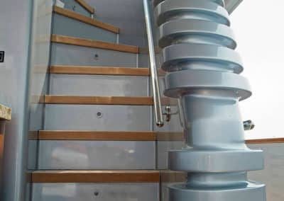 Stairways from deck to deck on the exterior of a Super Yacht, designed by Patrick Knowles Designs
