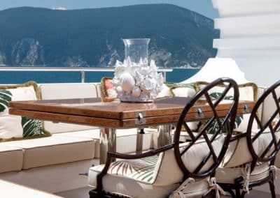 Beautiful table, chairs and sofa on the deck of a superyacht, design by Patrick Knowles Designs