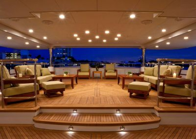 Evening setting on well lit deck with plenty of seating designed by Superyacht designer Patrick Knowles