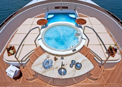 """Top view of deck below with Jacuzzi and beautiful setting on superyacht """"Mi Sueño"""" designed by Fort Lauderdale based Patrick Knowles Designs"""