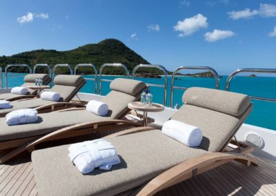 Beautiful Chaise lounge chairs with island and open seas designed by Fort Lauderdale yacht designer Patrick Knowles