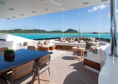 Dining and seating area on deck beautifully designed by Fort Lauderdale yacht designer Patrick Knowles