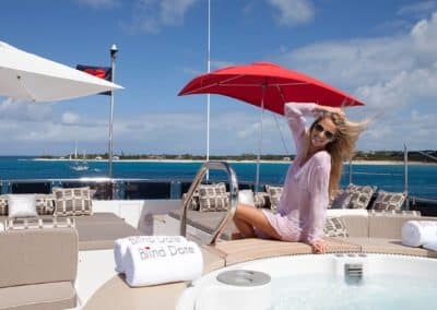 "Photograph of beautiful woman on top deck by a Jacuzzi of superyacht ""Blind Date"" designed by Fort Lauderdale yacht designer Patrick Knowles"