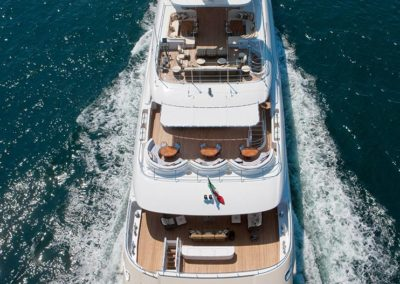 Top view of superyacht in motion showing all decks of the yacht designed by Fort Lauderdale yacht designer Patrick Knowles