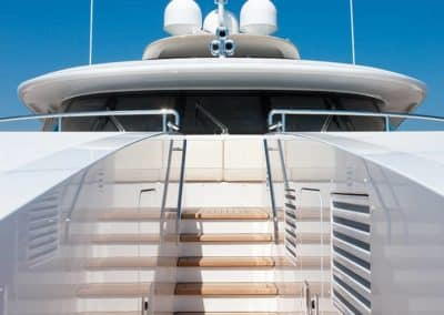 Photograph of stairway leading to top deck by the bridge on superyacht designed by Fort Lauderdale yacht designer Patrick Knowles