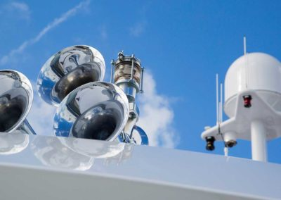 Closeup photograph of horns and navigation antenna on top of superyacht designed by Patrick Knowles Designs