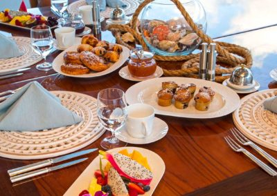 Closeup of breakfast food on dining table designed by Fort Lauderdale yacht designer Patrick Knowles