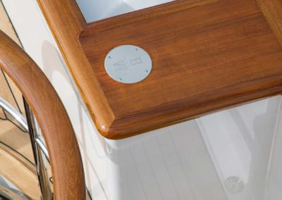 Closeup detail photograph of logo of yacht by stairway designed by Fort Lauderdale yacht designer Patrick Knowles