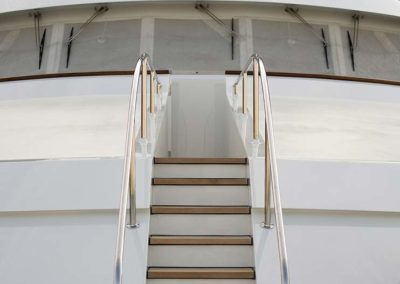 Photograph of stairs leading from deck to deck on superyacht designed by Fort Lauderdale yacht designer Patrick Knowles
