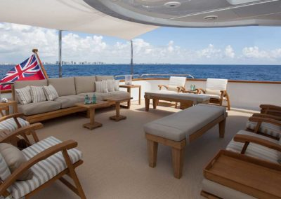 Photograph of top deck seating area with multiple outdoor seating designed by Fort Lauderdale yacht designer Patrick Knowles