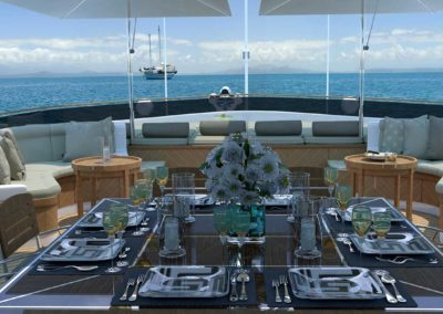 Dining table on the deck in the middle of the day with a view of the open sea of a yacht designed by Fort Lauderdale yacht designer Patrick Knowles
