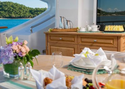 Breakfast on a yacht overlooking the sea and mountains