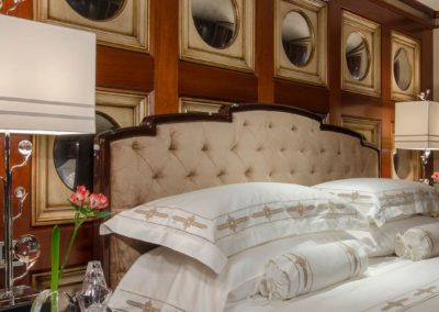 Beautiful bed setting in stateroom of superyacht designed by Fort Lauderdale yacht designer Patrick Knowles