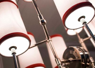 Red and white light sconce on a mirror