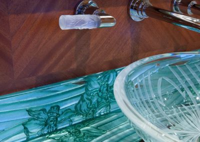 Bathroom and yacht head detail photograph of a custom glass counter and crystal sink bowl