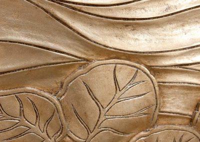 Detail of metallic wall carvings