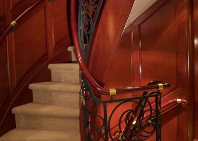 Carved curly handrail for a yacht stairway banister