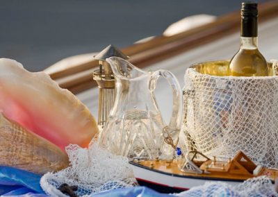 Shell and marine themed tablescape for afternoon wine on a yacht