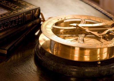 Gold compass tabletop accessory