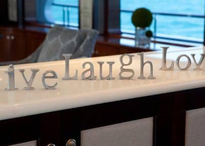 Live laugh love signs on a yacht counter top