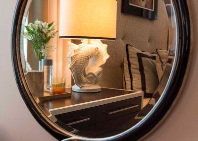 Circular mirror reflecting a fish lamp