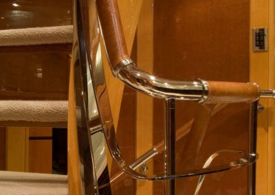 metal railing in yacht stairwell designed by Patrick Knowles