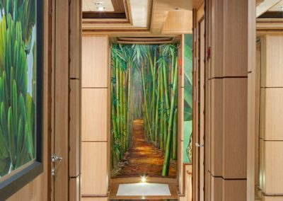 Tropical and bamboo themed hallway and closets designed by Patrick Knowles on a private superyacht