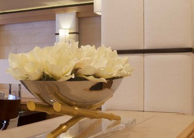 Metal bowl filled with white flowers as a room accessory on a private yacht designed by Patrick Knowles Designs.