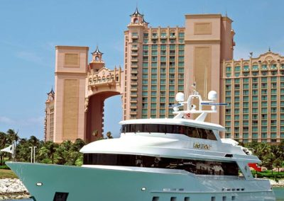 Exterior photograph of a superyacht designed by Patrick Knowles on the water in front of Atlantic in the Bahamas